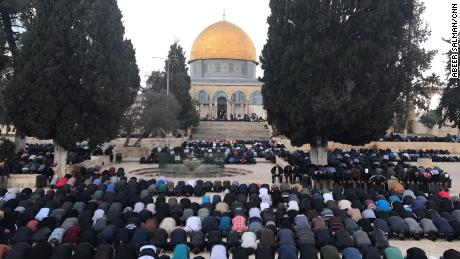 Friday Prayers take place outside Jerusalem's Al Aqsa mosque.