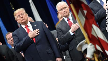 President Donald Trump stands with Attorney General Jeff Sessions on December 15, 2017 in Quantico, Virginia, before participating in the FBI National Academy graduation ceremony.