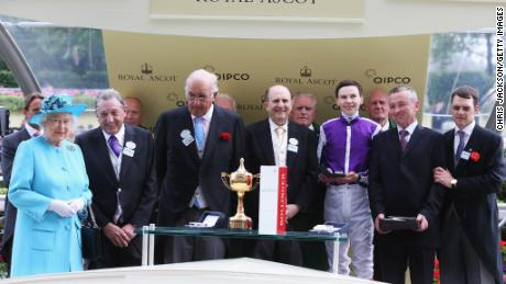 Queen presents the Ascot Gold Cup to winning owners Derek Smith, John Magnier and Michael Tabor in 2014.