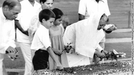 Indira Gandhi, accompanied by her grandchildren Rahul Gandhi and Priyanka Gandhi, in New Delhi, May 27, 1980.