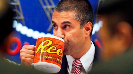 Federal Communications Commission (FCC) Chairman Ajit Pai takes a drink from a mug during an FCC meeting where the FCC will vote on net neutrality, Thursday, Dec. 14, 2017, in Washington. (AP Photo/Jacquelyn Martin)