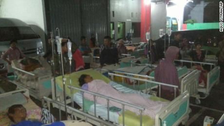 Patients are evacuated outside a hospital in Banyumas overnight after an earthquake.