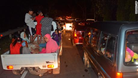 Vehicles are stuck in traffic as people try to reach higher ground amid fears of a tsunami, following an earthquake in Cilacap, Central Java, Indonesia, Saturday, Dec. 16, 2017.  The strong earthquake shook the island of Java triggering a tsunami warning for parts of the main island's coastline. (AP Photo/Wagino)