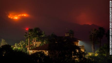 MONTECITO, CA - DECEMBER 16: Flames threaten homes at the Thomas Fire on December 16, 2017 in Montecito, California. The National Weather Service has issued red flag warnings of dangerous fire weather in Southern California for the duration of the weekend. Prior to the weekend, Los Angeles and Ventura counties had 12 consecutive days of red flag fire warnings, the longest sustained period of fire weather warnings on record. The Thomas Fire is currently the fourth largest California fire since records began in 1932, growing to 400 square miles and destroying more than 1,000 structures since it began on December 4. (Photo by David McNew/Getty Images)