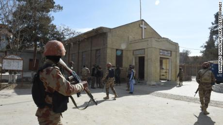 Pakistani security personnel take position after suicide bombers attacked a Methodist church during a Sunday service in Quetta on December 17, 2017. At least five people were killed and 15 wounded when two suicide bombers attacked a church in Pakistan during a service on December 17, just over a week before Christmas, police said. The attack took place at the Methodist Church in the restive southwestern city of Quetta in Balochistan province.   / AFP PHOTO / BANARAS KHAN        (Photo credit should read BANARAS KHAN/AFP/Getty Images)