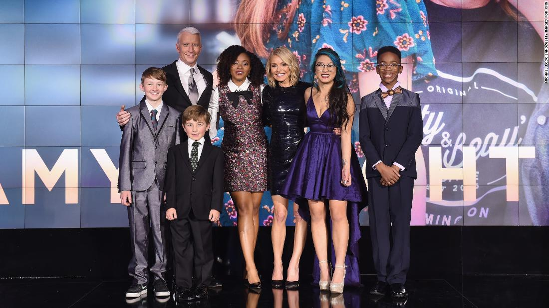 Anderson Cooper poses with CNN's Young Wonders, from left to right: Campbell Remess, Ryan Hickman, Haile Thomas, Christina Li, and Sidney Keys III