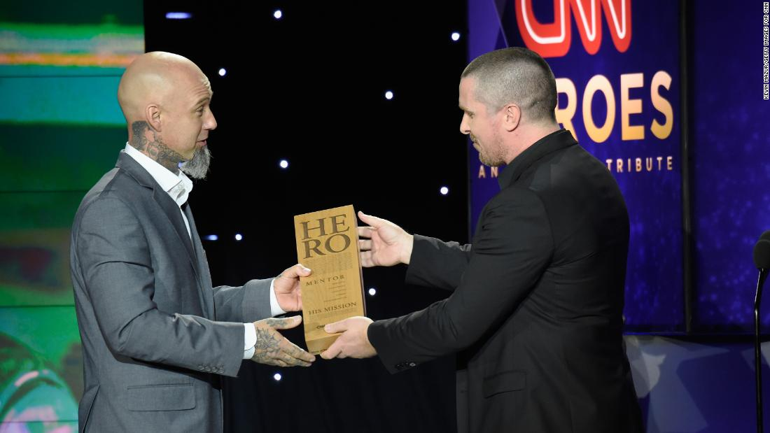 2017 CNN Hero Aaron Valencia, left, accepts his award from actor Christian Bale.