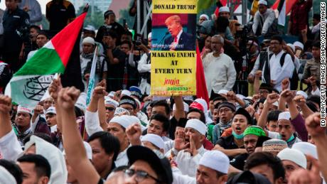 Protesters show banners and shout slogans in the Indonesian capital of Jakarta.