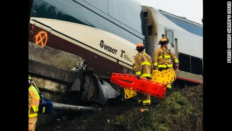 First responders survey the scene of the derailment.
