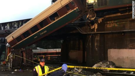NS Slug: WA:AMTRAK DERAILMENT-TRAIN TRUCK UNDER BRIDGE  Synopsis: Deaths reported aboard Amtrak train that derailed over Washington state highway  Video Shows: Train truck under bridge, train car hanging from overpass    Keywords: WASHINGTON TRAIN PIERCE COUNTY