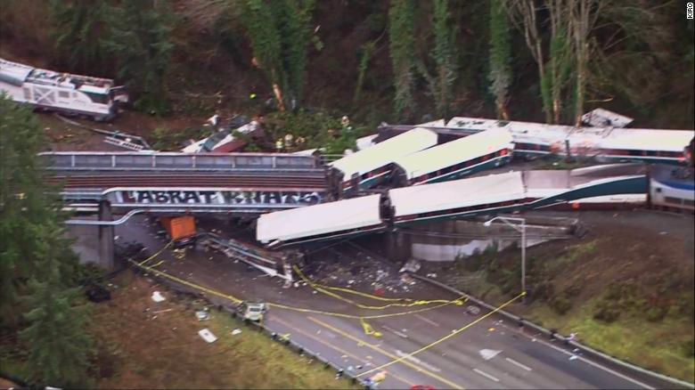 Aerial images show the deadly Amtrak derailment with the train sprawled across the track and highway on Monday.