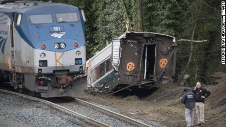 DUPONT, WASHINGTON - DECEMBER 18:  Law enforcement work at the scene of a Amtrak train derailment on December 18, 2017 in DuPont, Washington. At least six people were killed when a passenger train car plunged from the bridge. The derailment also closed southbound I-5.  (Photo by Stephen Brashear/Getty Images)