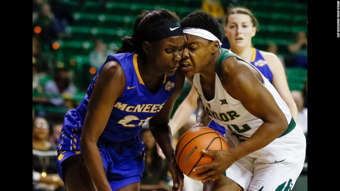 McNeese State forward Mercedes Rogers bumps heads with Baylor guard Moon Ursin during a college basketball game in Waco, Texas, on Wednesday, December 13.