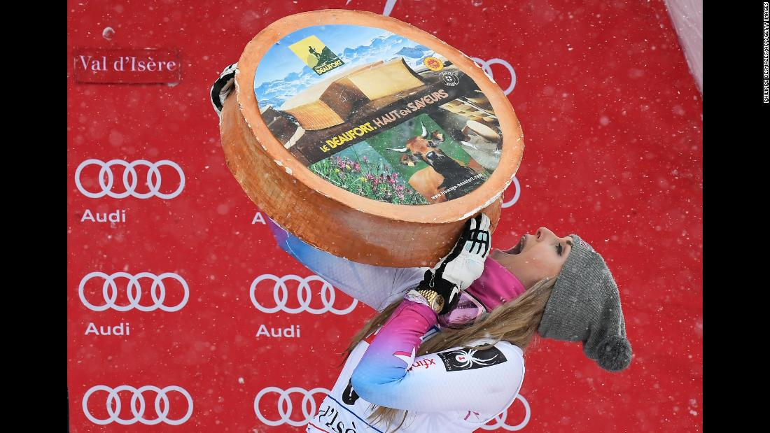 "American skier Lindsey Vonn celebrates with a wheel of cheese after <a href=""http://www.cnn.com/2017/12/16/sport/lindsey-vonn-skiing-world-cup-val-disere/index.html"" target=""_blank"">winning a World Cup super-G race</a> in Val-d'Isere, France, on Saturday, December 16. It was Vonn's first victory since a downhill race in January."
