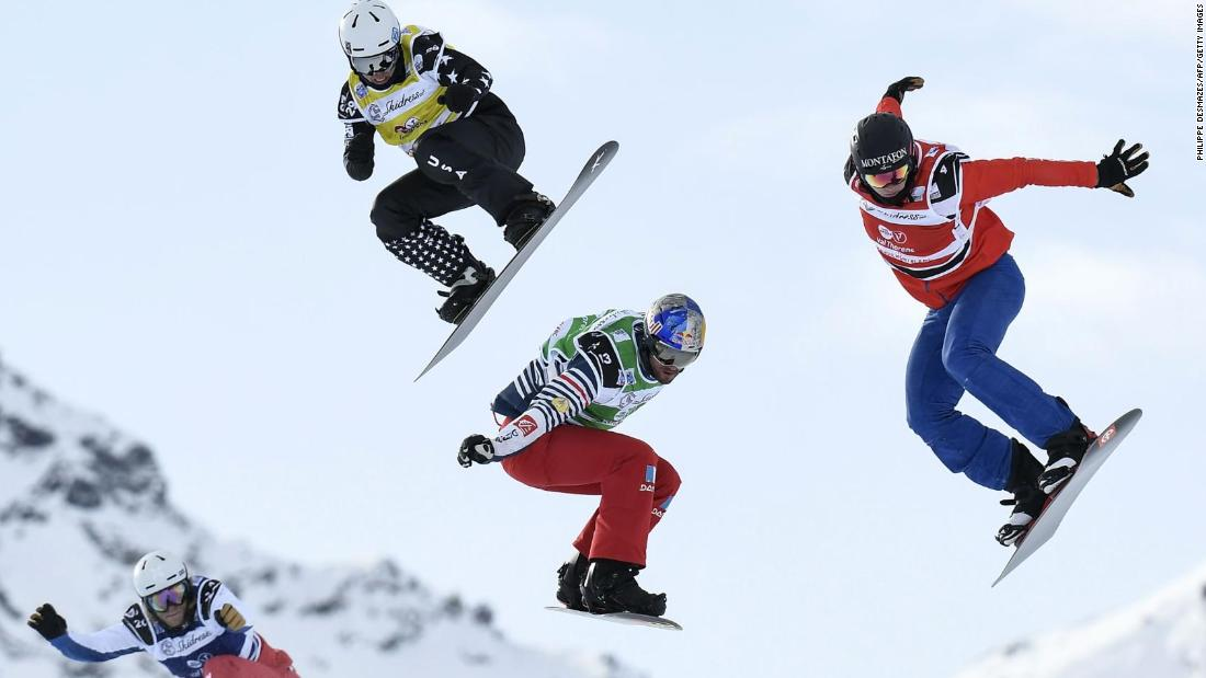 From left, snowboarders Fabio Corbi, Regino Hernandez, Nate Holland and Alex Pullin compete in a World Cup race at the French ski resort of Val Thorens on Wednesday, December 13.