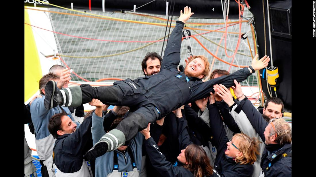 "Francois Gabart celebrates Sunday, December 17, after he became the fastest person to sail solo nonstop around the world. The 34-year-old Frenchman left Ouessant, off the west coast of France, on November 4 and raced eastward around the globe to finish in 42 days, 16 hours, 40 minutes and 35 seconds. <a href=""http://www.cnn.com/2017/12/18/sport/francois-gabart-round-the-world-record-sailing/index.html"" target=""_blank"">He shattered the previous record</a> by more than six days."