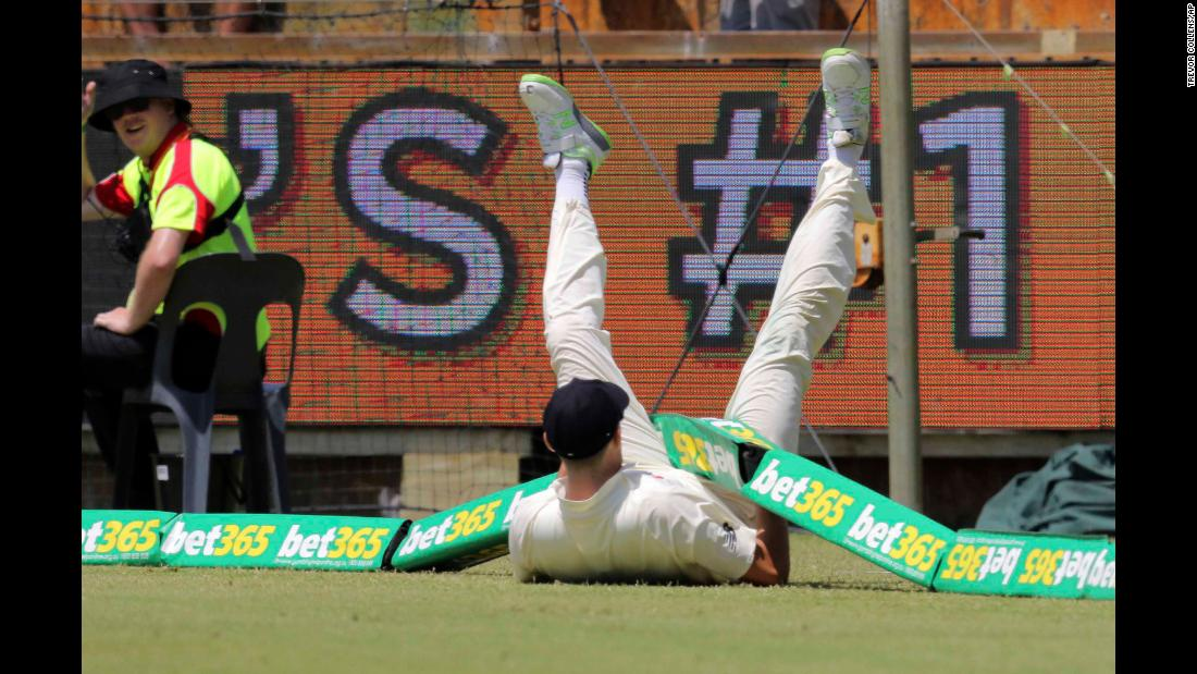 England cricketer Craig Overton gets tangled in the boundary during an Ashes match in Perth, Australia, on Saturday, December 16.