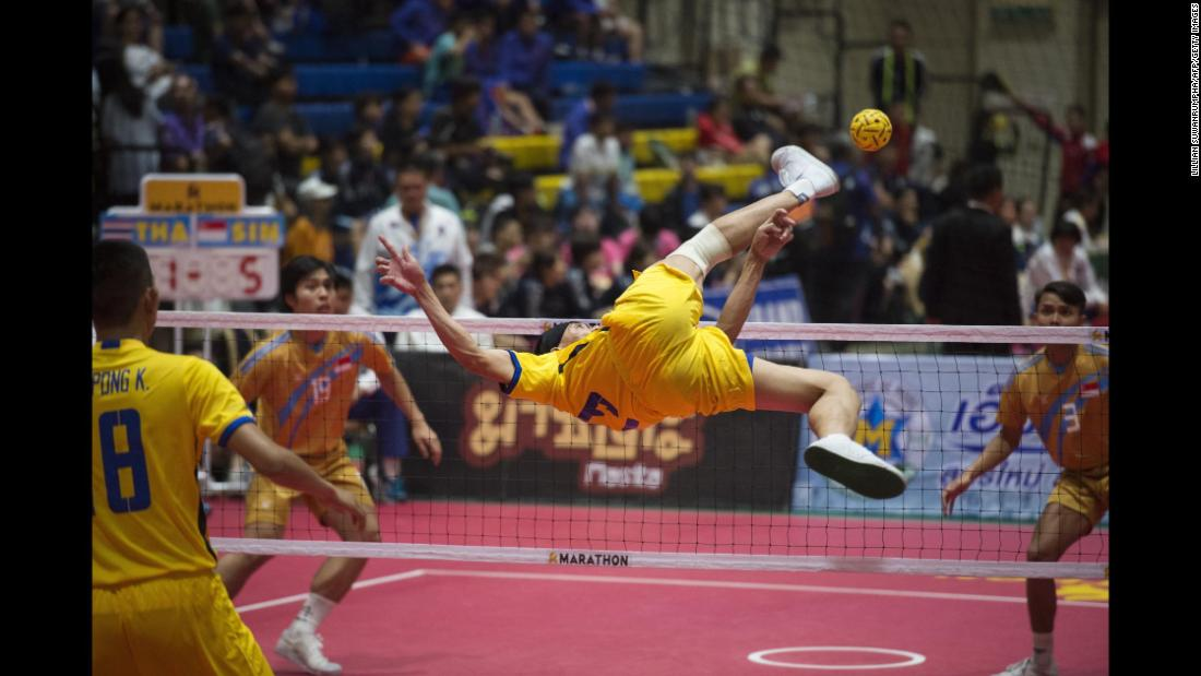 A sepak takraw player from Thailand spikes the ball over the net during a King's Cup match against Singapore on Thursday, December 14.