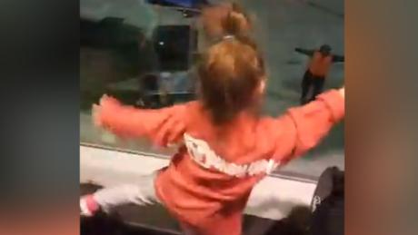 Two little girls have a dance-off with Southwest Airlines employee.