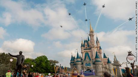 In this handout photo provided by Disney Parks, in a special moment for Magic Kingdom guests, the U.S. Navy Flight Demonstration Squadron, the Blue Angels, streaked across the skies above, Cinderella Castle March 19, 2015 at Walt Disney World Resort in Lake Buena Vista, Florida.  The flyover featured the Blue Angels' six-jet F/A-18 Hornet Delta Formation making two dramatic passes above the Magic Kingdom, with Cinderella Castle as a focal point, en route to an air show in Florida.