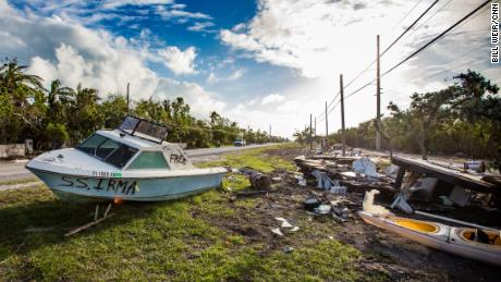 A wrecked boat and other trash awaits removal. Pickup costs have soared since Hurricane Irma.