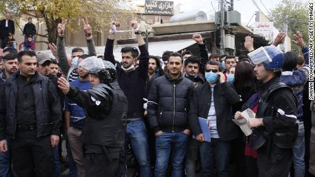 Iraqi Kurdish protesters shout slogans in Sulaymaniyah on December 19.