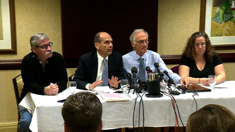 From left to right, Robert Costello, attorney Mitchell Garabedian, Phil Saviano and Alexa MacPherson speak at Garabedian's Boston office about the death of Cardinal Bernard Law on Wednesday.