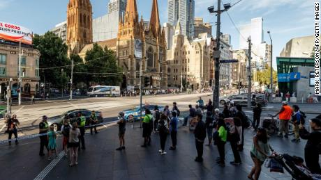 The street outside Flinders Street station is cordoned off by Australian police at the scene where a car ran over pedestrians in downtown Melbourne on December 21, 2017.