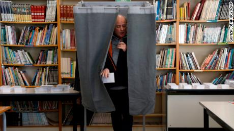 A man leaves a voting booth after casting a ballot on Thursday in Tarragona.