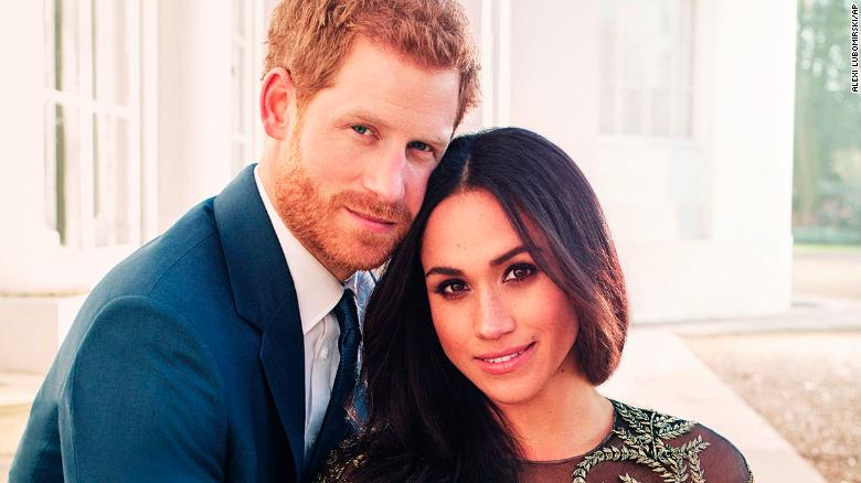 Britain's Prince Harry and Meghan Markle pose for one of two official engagement photos, at Frogmore House, in Windsor.