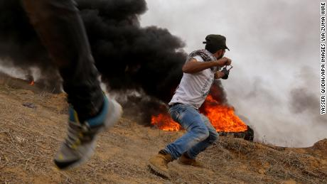 Palestinian protesters clash with Israeli security forces on Friday near the border with Israel in southern Gaza.