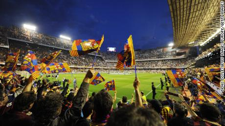 Barcelona fans cheer their team during the Copa del Rey against Real