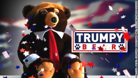 "Trump plus bear equals Trumpy Bear...bizarro gift of the holiday season. Jeanne Moos cuddles one.    Trumpy Bear   It's the perfect Christmas gift for...we're not sure who. You may or may not have ever seen the TV infomercial for Trumpy Bear and, even if you saw it, you probably couldn't tell if it was real. That's the joy of this story...the hilarious commercial hawking the plush stuffed bear with Donald Trump's hair and a flag that looks like a cape when you pull it out of the zipper pouch on his back. Only two easy payments of $19.95!   ""And no, this is not a joke"",  writes the designer to CNN...""I felt it was time to name an American fearless grizzly bear after our new Commander and Chief."" The designer teamed up with a company that specializes in making TV infomercials and this is a classic. We have obtained our very own Trumpy Bear, who unfortunately can't tweet because he has no fingers. But what he lacks in digits, he more than makes up for with the red tie and unruly hair. Just stop everything and watch the commercial. Comes complete with a Certificate of Authenticity, which we play off against Trump demanding to see a certain birth certificate."
