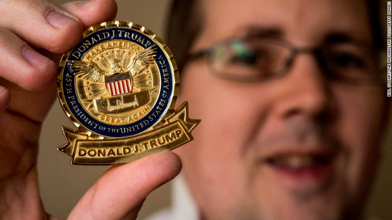 "John Wertman, a coin collector, with his Trump ""challenge coin"" on December, 21, 2017 in Burke, VA."