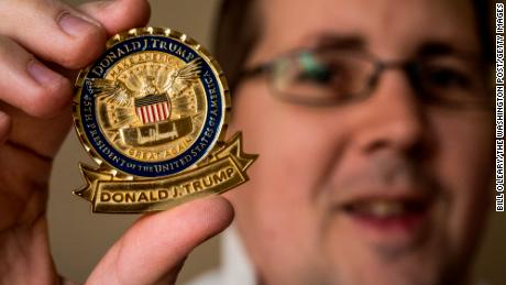 "BURKE, VA - DECEMBER 21: John Wertman, a coin collector, with his  Trump ""challenge coin"" on December, 21, 2017 in Burke, VA. (Photo by Bill O'Leary/The Washington Post via Getty Images)"