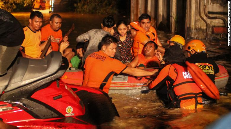 Rescue workers evacuate flood-affected residents in Davao on the southern Philippine island of Mindanao after Tropical Storm Tembin dumped torrential rains across the island.