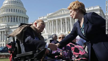 WASHINGTON, DC - MARCH 09:  Sen. Debbie Stabenow (D-MI) (R) thanks Kent Keyser following a news conference with people who may be negatively affected by the proposed American Health Care Act, the Republicans' attempt to repeal and replace Obamacare, outside the U.S. Capitol March 9, 2017 in Washington, DC. Stabenow and fellow Democratic and Independent senators urged Republicans to drop their healthcare legislation, saying it would disproportionally affect people with disabilities and women and small business owners.  (Photo by Chip Somodevilla/Getty Images)