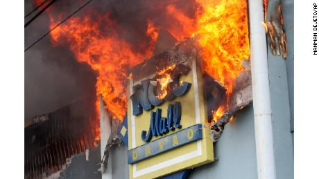 A fire rages at the NCCC shopping mall on Saturday, December 23, 2017, in Davao City.
