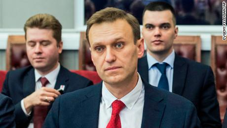 Russian opposition leader Alexei Navalny, who submitted endorsement papers necessary for his registration as a presidential candidate, center, sits at the Russia's Central Election commission in Moscow, Russia, Monday, Dec. 25, 2017. Russian election officials have formally barred Russian opposition leader Alexei Navalny from running for president. (Evgeny Feldman/Navalny Campaign via AP)