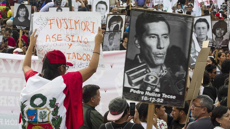 Demonstrators march in Lima on Monday to protest the presidential pardon for Fujimori.