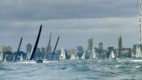 Yachts sail at the start of the Sydney to Hobart Yacht Race on Sydney Harbour on December 26, 2017. / AFP PHOTO / SAEED KHAN / --IMAGE RESTRICTED TO EDITORIAL USE - STRICTLY NO COMMERCIAL USE--        (Photo credit should read SAEED KHAN/AFP/Getty Images)