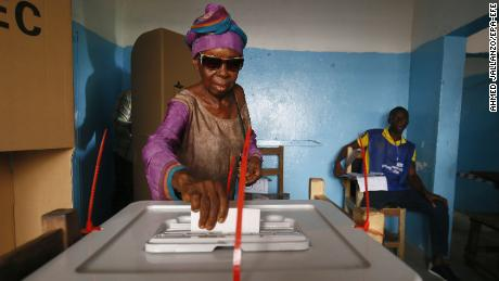 A voter casts her ballot in Monrovia, the capital of Libera.