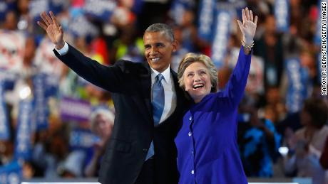 Then-President Barack Obama and Democratic presidential nominee Hillary Clinton acknowledge the crowd on the third day of the Democratic National Convention at the Wells Fargo Center, July 27, 2016 in Philadelphia, Pennsylvania.