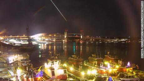 A possible meteor streaked over New England on Tuesday evening. A web camera at the Portsmouth harbor caught it as it passed through the sky.
