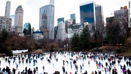 People skate at the ice rink at Central Park on Christmas day in New York City.