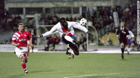 PSG's George Weah kicks the ball during a Champions League match against Spartak Moscow in 1994.