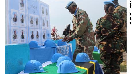 Helmets of Tanzanian UN peace keepers who were killed by suspected Ugandan rebels are displayed during a tribute ceremony in Goma.