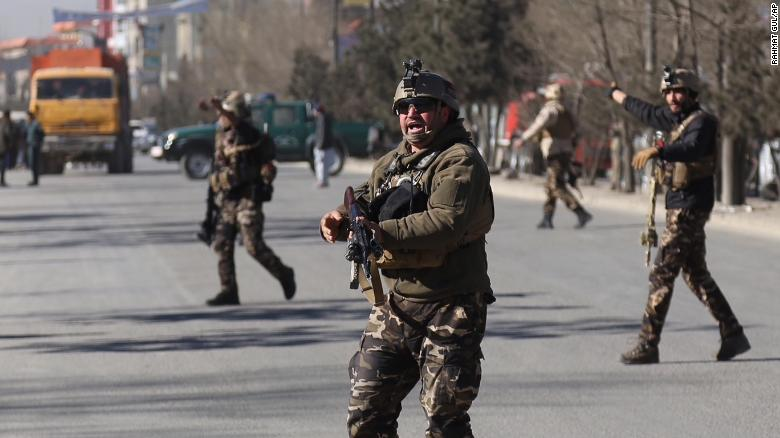 Security personnel arrive outside the site of a suicide attack in kabul, Afghanistan.