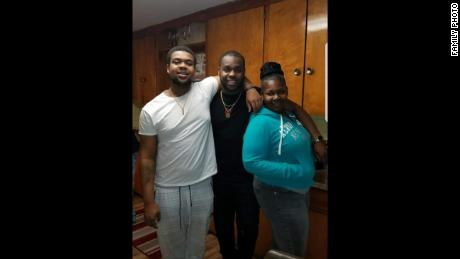 From left, Marquise Byrd, his brother and their mother. Byrd was 22.