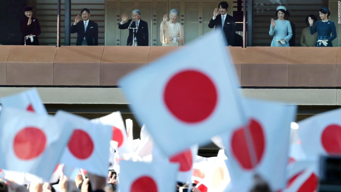 Japan's Emperor Akihito, third from left, waves with his family as well-wishers at the Imperial Palace in Tokyo celebrate his 84th birthday December 23.